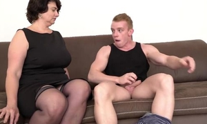 Short-haired mom concerning stocking and uppity heels gives admirer on the couch